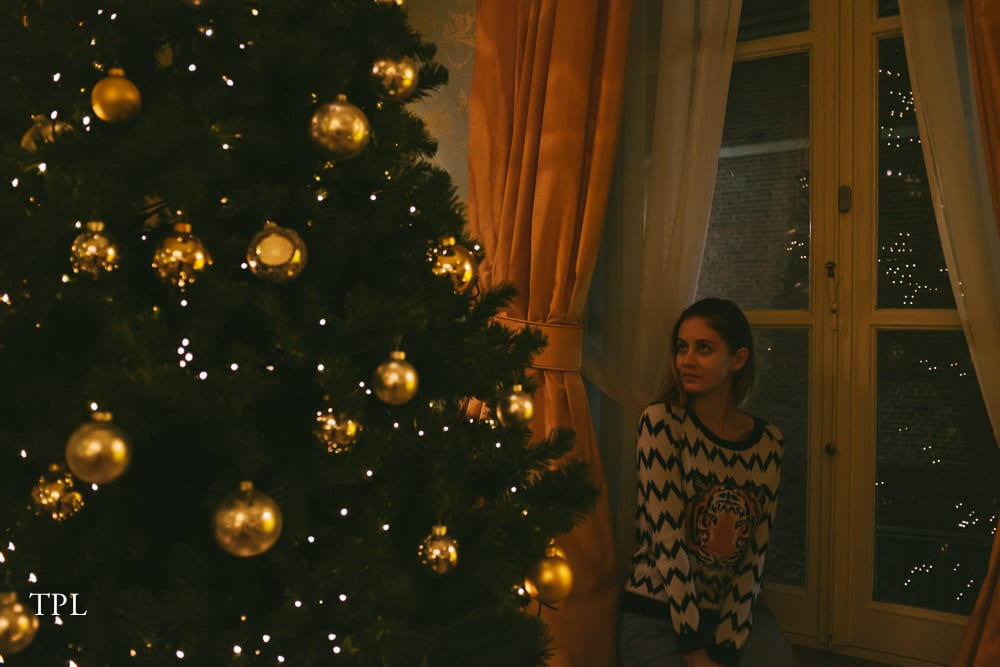 Sitting next to the Christmas Tree