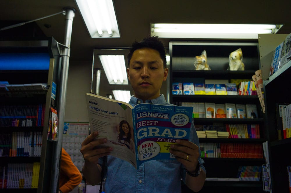 Browsing the hotel's bookshop, Daniel's reading about his grad school